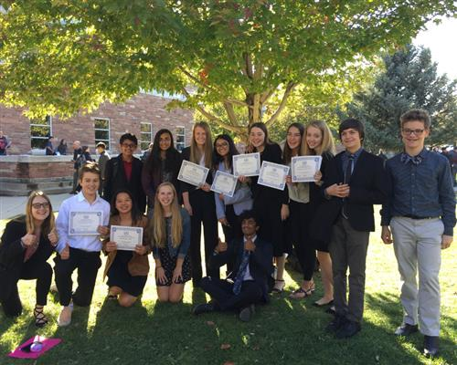 Model UN Team at Boulder Conference with award certificates.