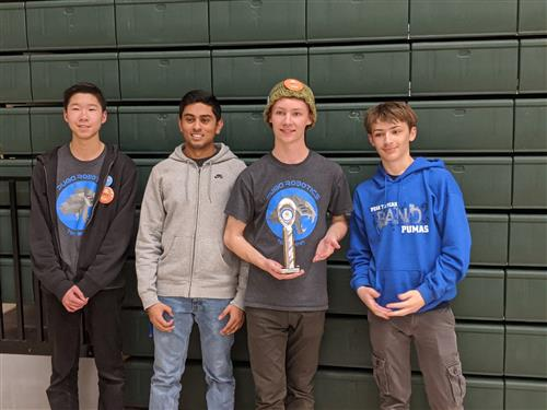 Robotics team with their trophy.