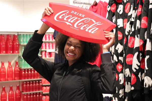 Makenna with Coca-Cola sign.